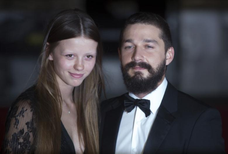 Shia LaBeouf poses with girlfriend Mia Goth. Photo credit: REUTERS/Neil Hall